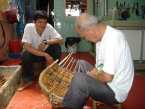 Sim Buck Teik working on rattan craft